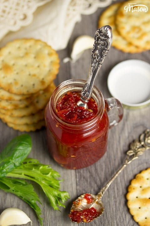 sweet chilli jam in a kilner jar with crackers, lettuce and garlic cloves