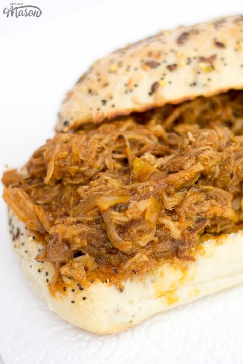 slow cooker pulled pork on a toasted roll