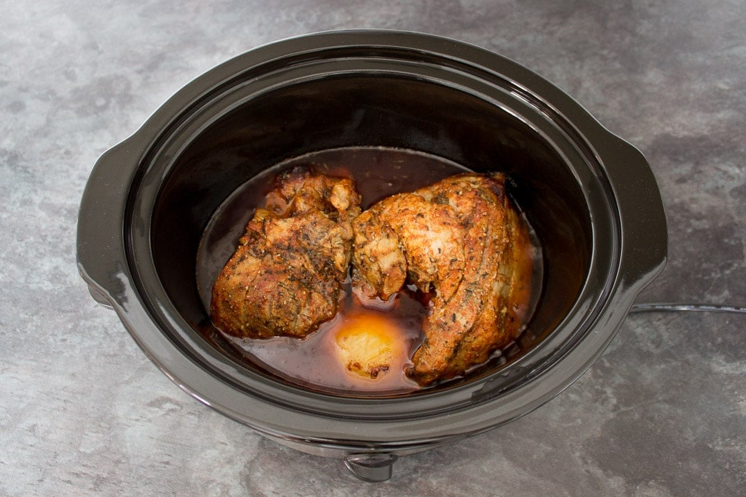 cooked pork in a slow cooker