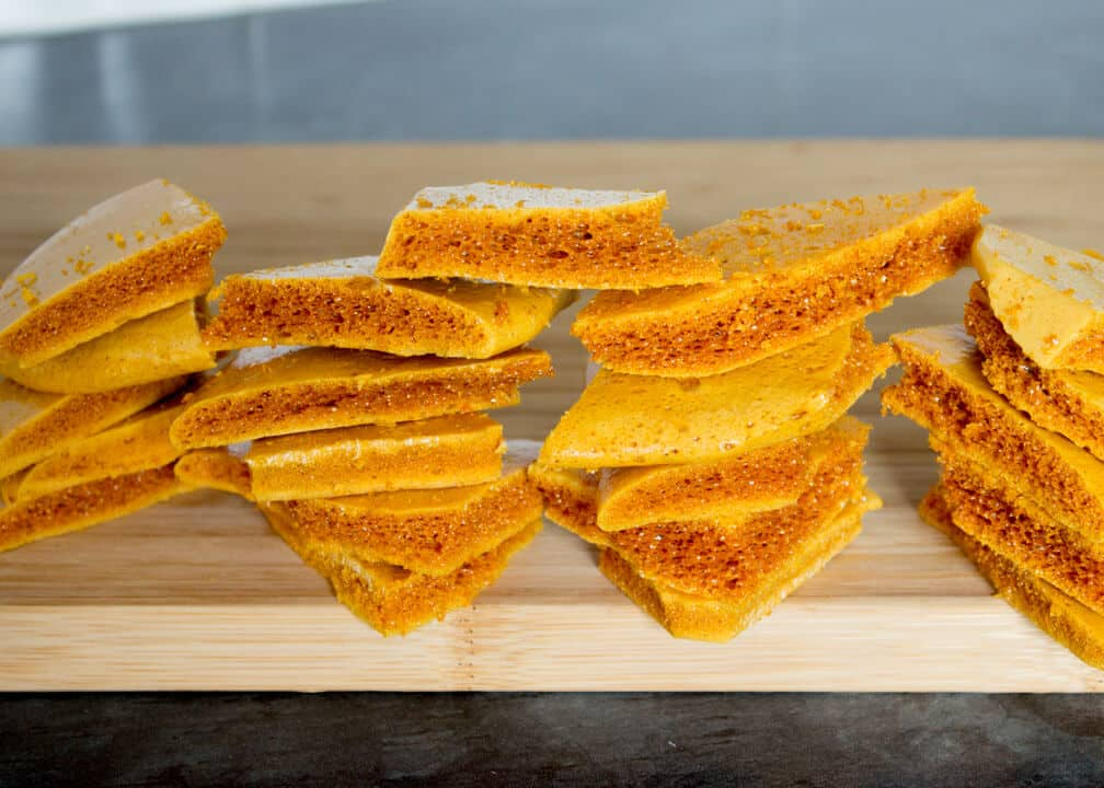 Chocolate Cinder Toffee Recipe: broken cinder toffee on a chopping board