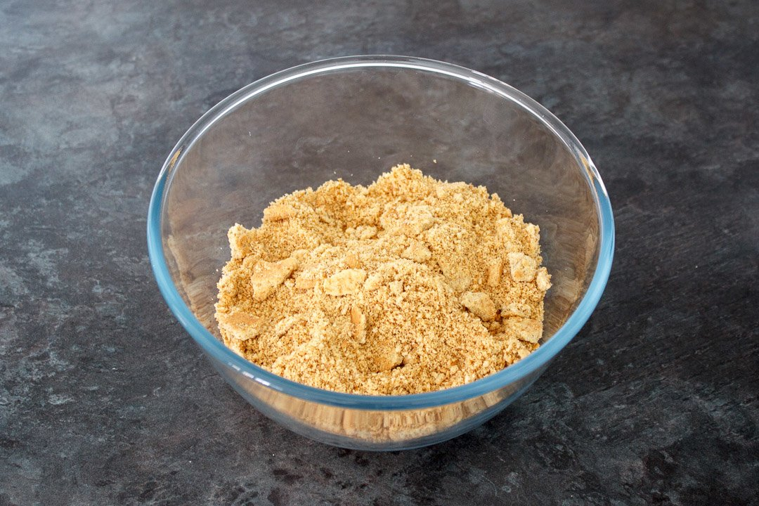 Biscuit crumbs in a large glass bowl