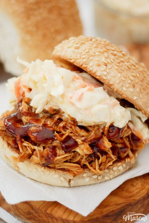 Slow cooker bbq chicken on a sesame seed bun with coleslaw