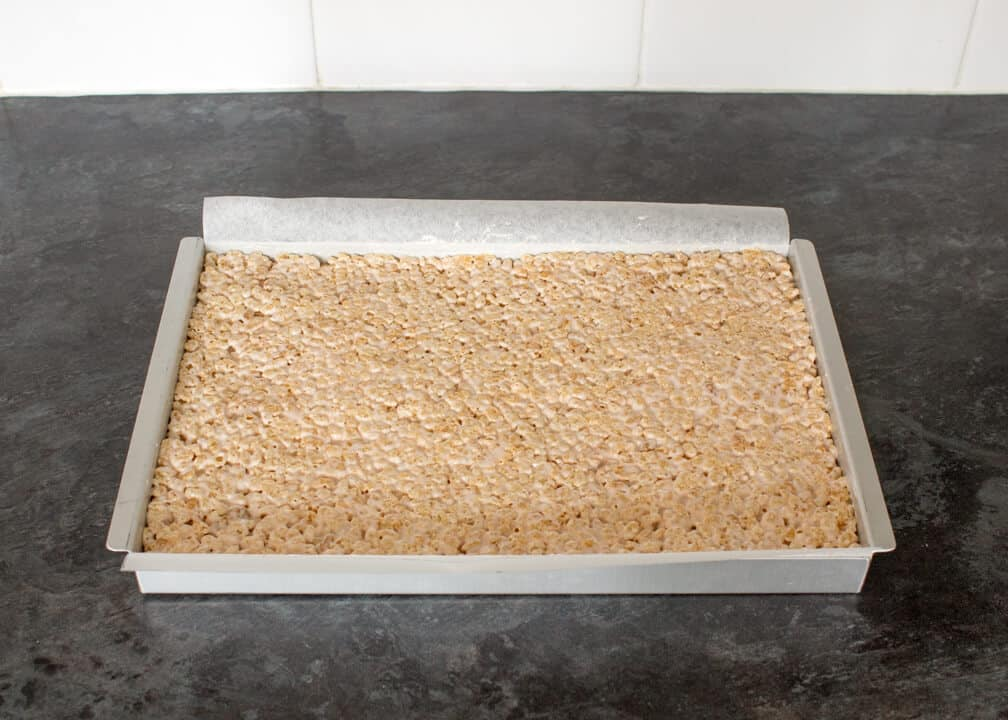 Caramel Krispie Bars: the krispies mixture pressed into a baking tray