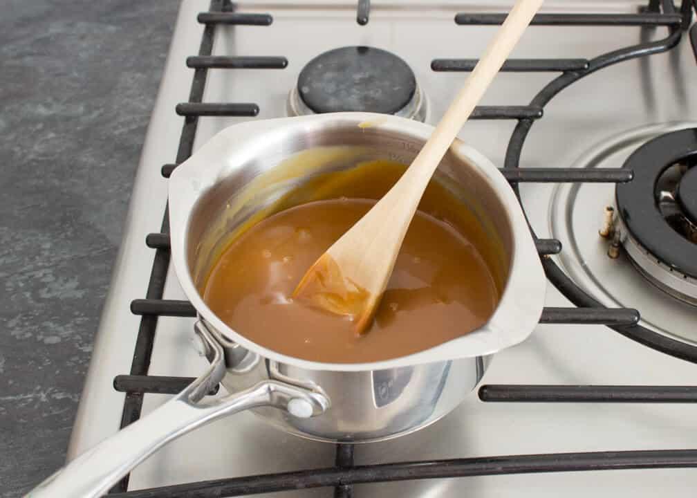 Caramel Krispie Bars mixture in a saucepan on the hob