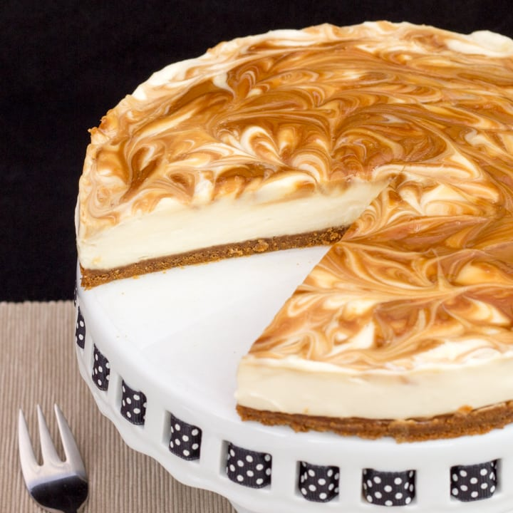 Biscoff Cheesecake on a cake stand