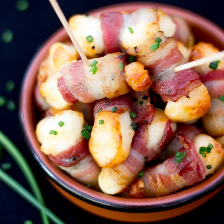 Bacon Halloumi Bites in a serving dish with cocktail sticks