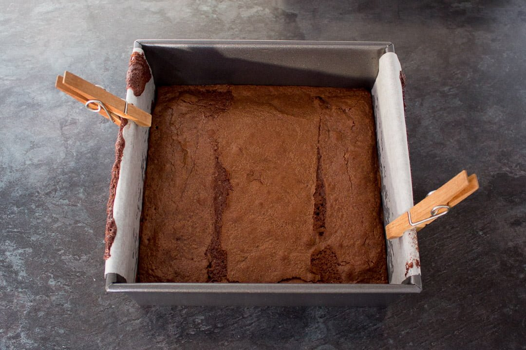 Baked fudgey brownies in a baking tin