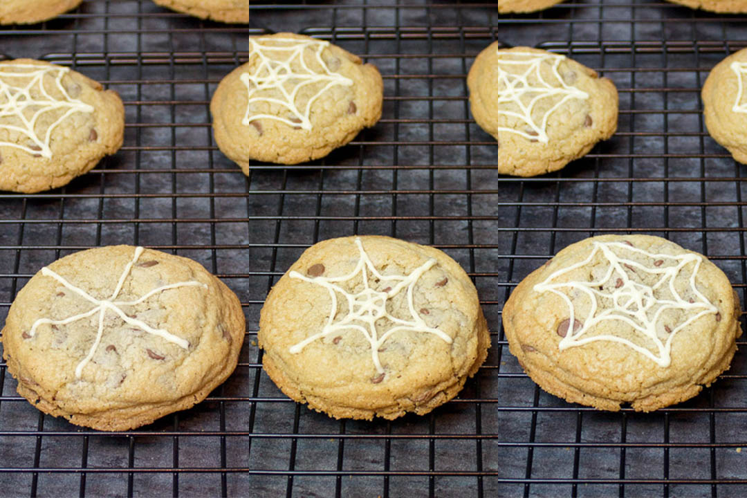 chocolate chip cookies with chocolate spider web design on top