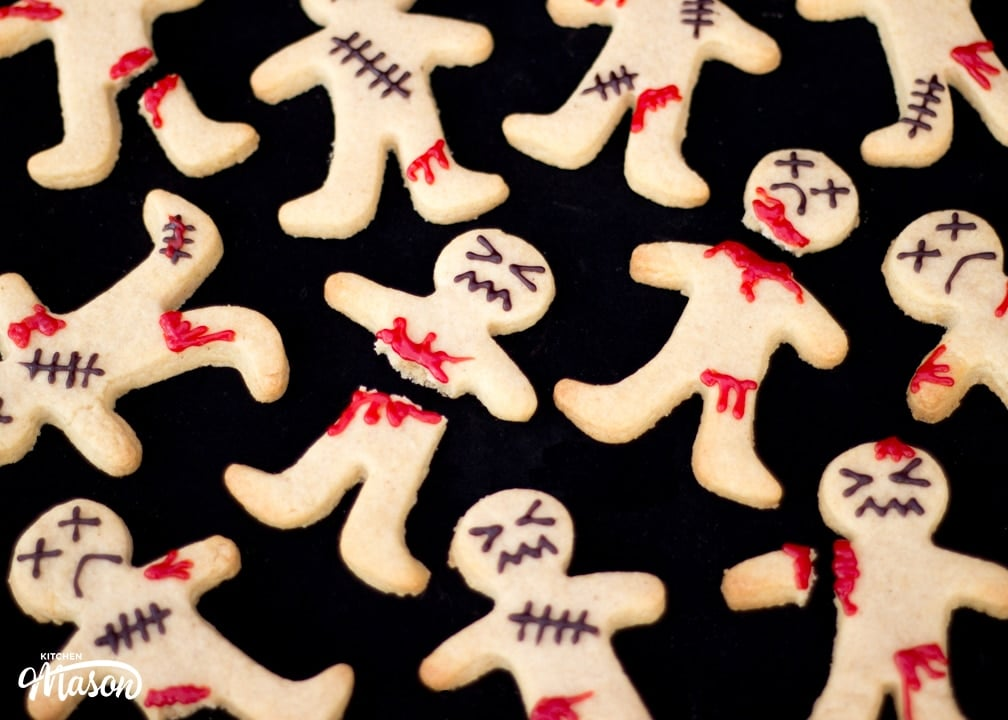 Decorated Ginger-Dead Men Halloween Cookies on a black background