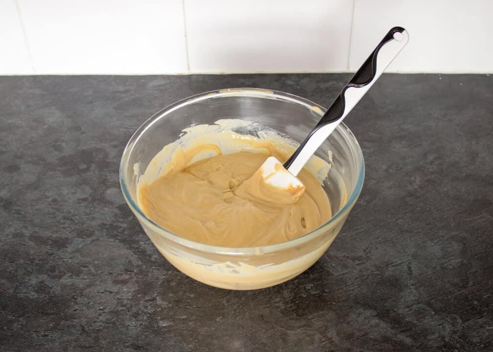Biscoff fudge mixture in a glass bowl