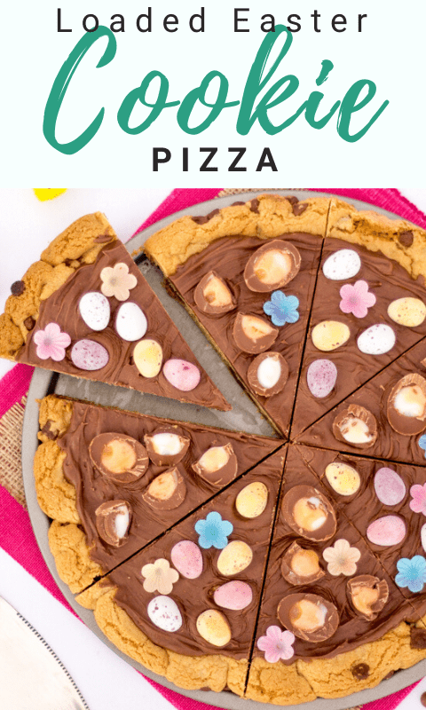 Easter chocolate cookie pizza sliced up on a pink piece of fabric