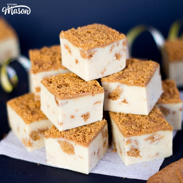 Biscoff fudge in a stack on baking paper