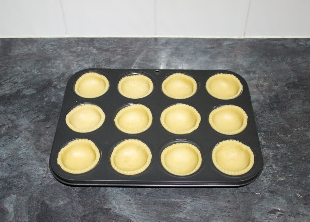 mince pies crusts in a muffin tin