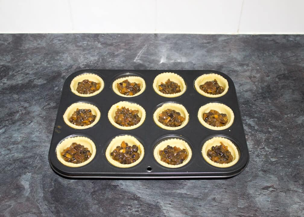 filled mince pies in a muffin tin