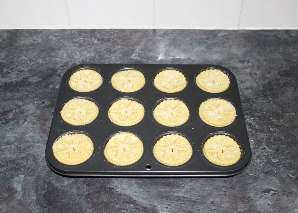 unbaked mince pies in a muffin tin