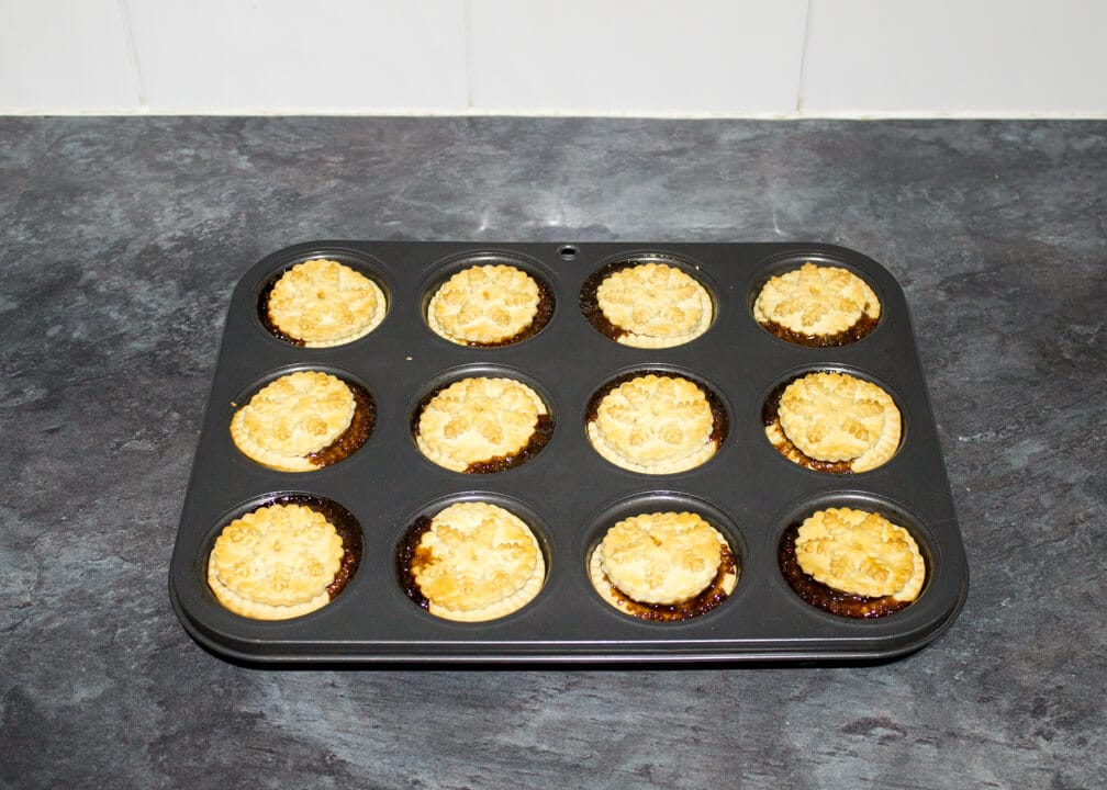 freshly baked mince pies in a muffin tin