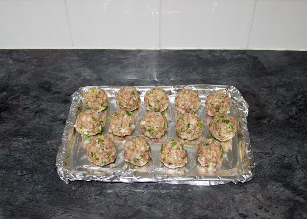Turkey meatballs rolled into balls on a foil lined baking tray