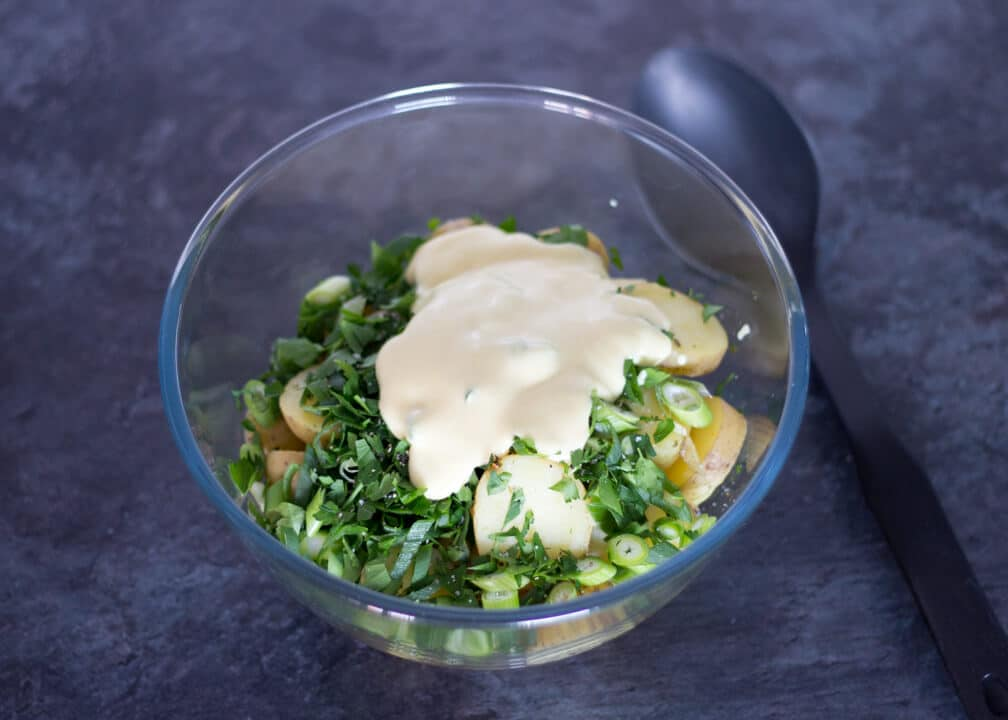 Boiled Potatoes in a Bowl with Spring Onion and Mayonnaise
