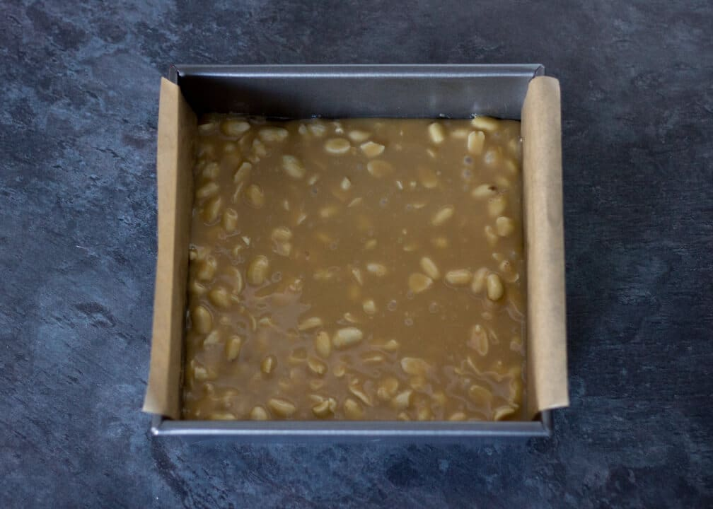 Snickers Millionaire Shortbread - caramel & peanuts in a baking tin