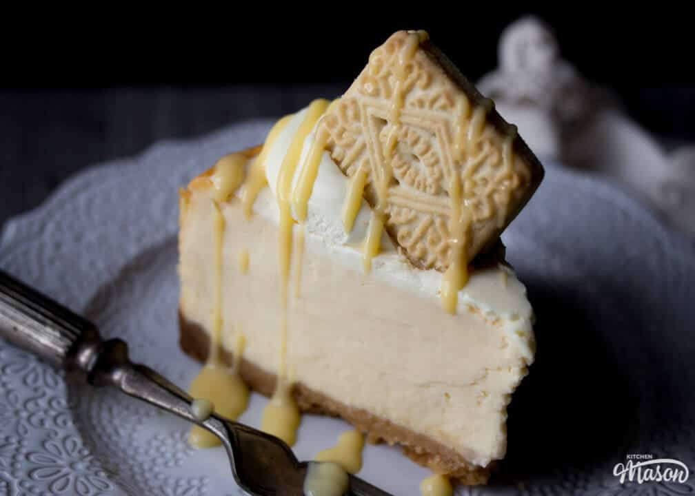 Custard cream baked cheesecake on a plate with a fork