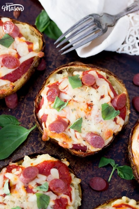Pizza loaded potato skins on a baking tray