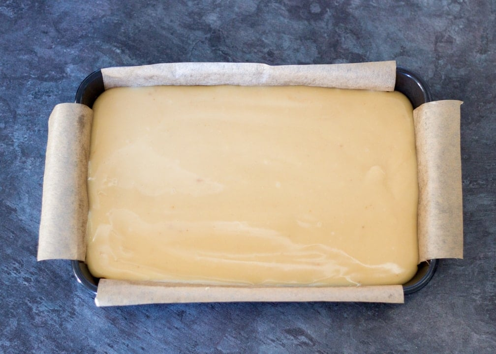 Chocolate Orange Caramel Shortbread: the caramel poured on top of the biscuit layer in a baking tin