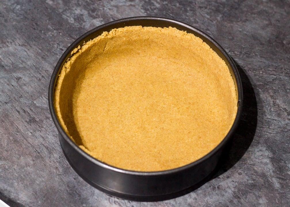 Vanilla Strawberry Cheesecake Recipe: Biscuit crumbs in a springform tin