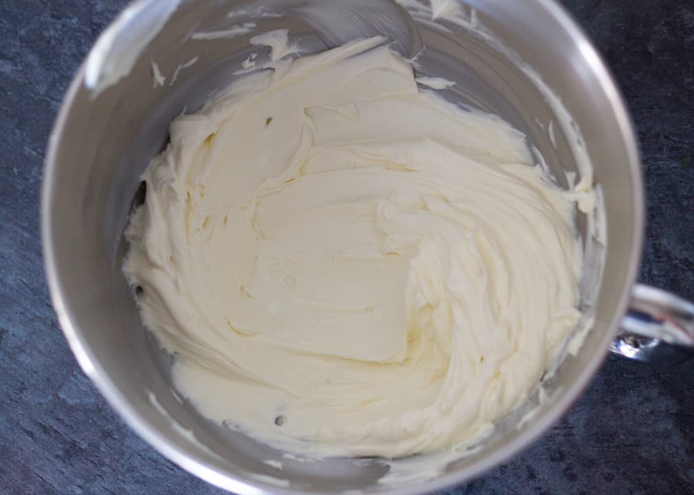 Lemon Cheesecake Recipe: softened cream cheese in a stand mixer bowl