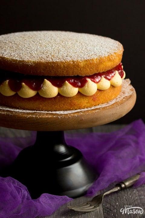 Rhubarb and custard cake on a cake stand