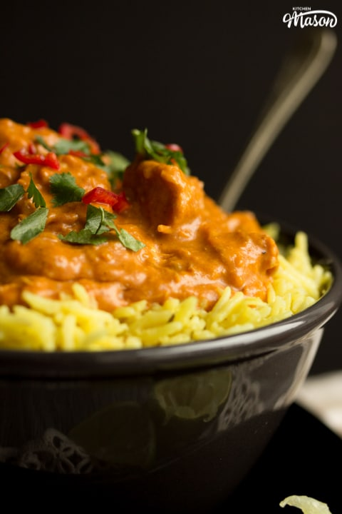 Slow cooker chicken curry in a bowl with rice