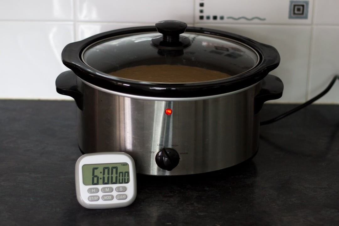 slow cooker chicken curry inside a slow cooker with a time that says 6 hours