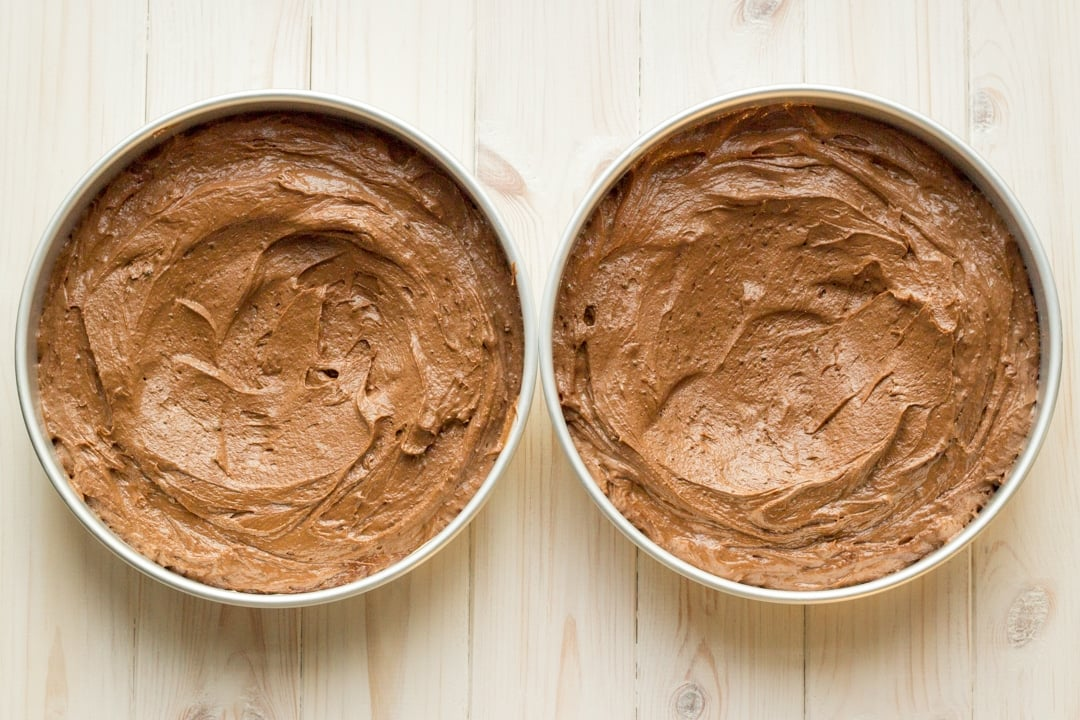 Easy chocolate cake recipe batter divided between two tins