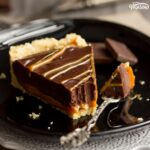 No Bake Caramel Chocolate Tart Recipe: A slice of no bake caramel chocolate tart on a plate with a fork