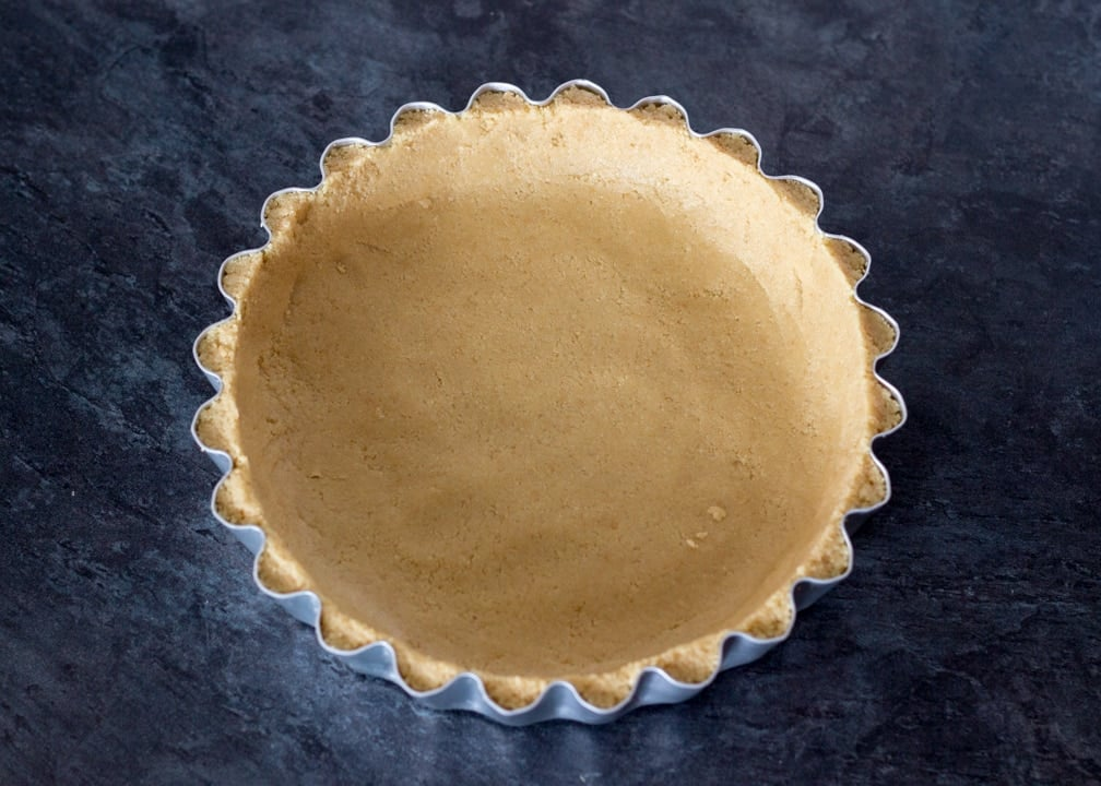 No Bake Caramel Chocolate Tart Recipe: biscuit base pressed into a fluted tart tin