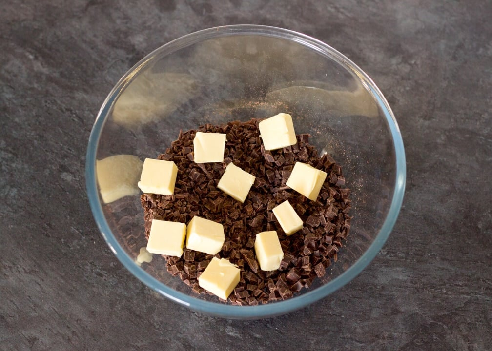 No Bake Caramel Chocolate Tart Recipe: butter and finely chopped chocolate in a glass bowl