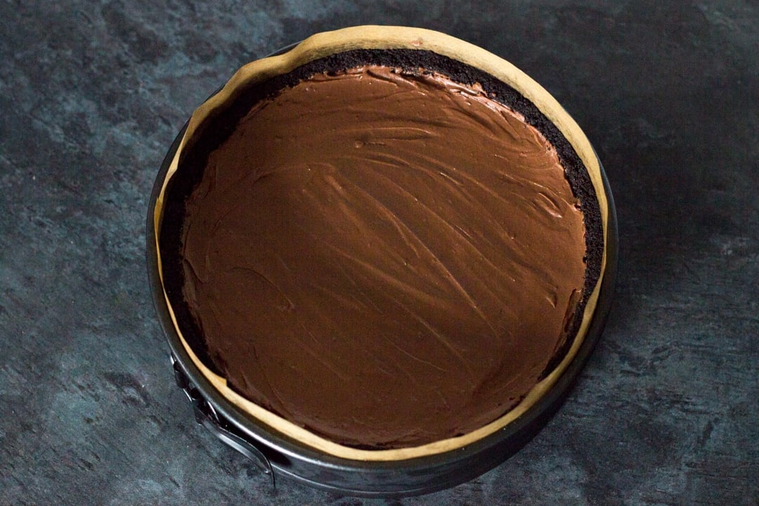 No Bake Chocolate Cheesecake filled smoothed out in a prepared base