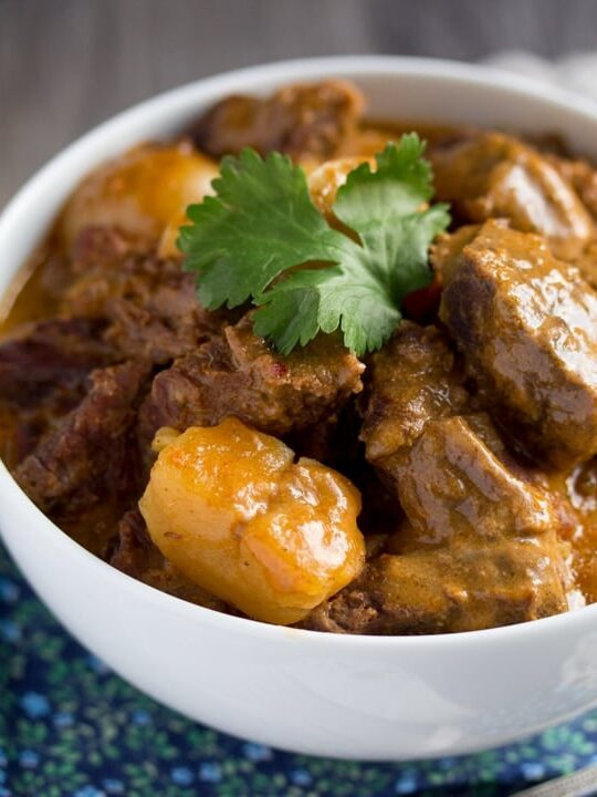 beef massaman curry in a white bowl