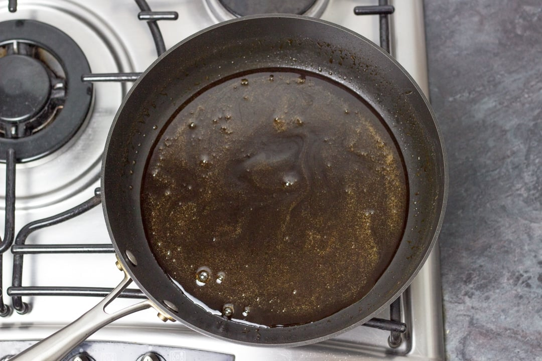 Chicken teriyaki sauce in a large frying pan