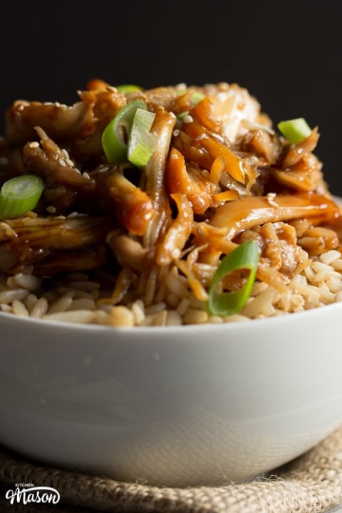 Chicken teriyaki recipe: chicken teriyaki in a bowl with rice sprinkled with sesame seeds and spring onion
