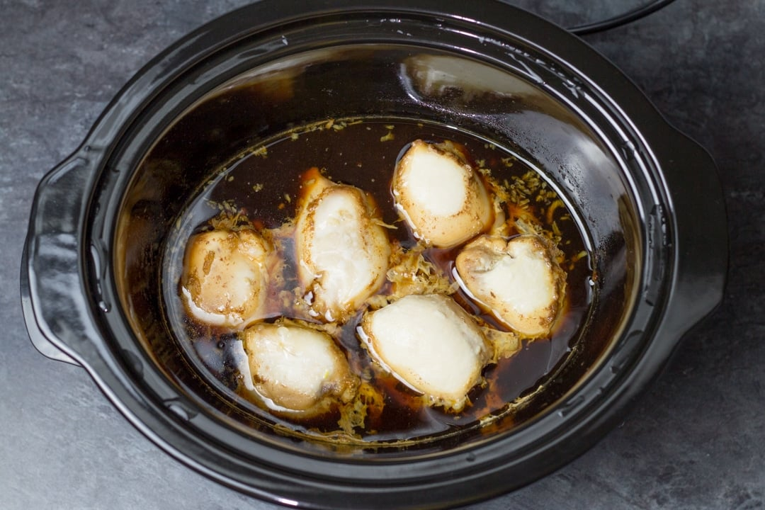 Chicken teriyaki recipe: cooked chicken thighs in a slow cooker covered in teriyaki sauce