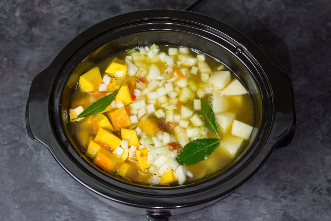 Pumpkin soup ingredients in a slow cooker