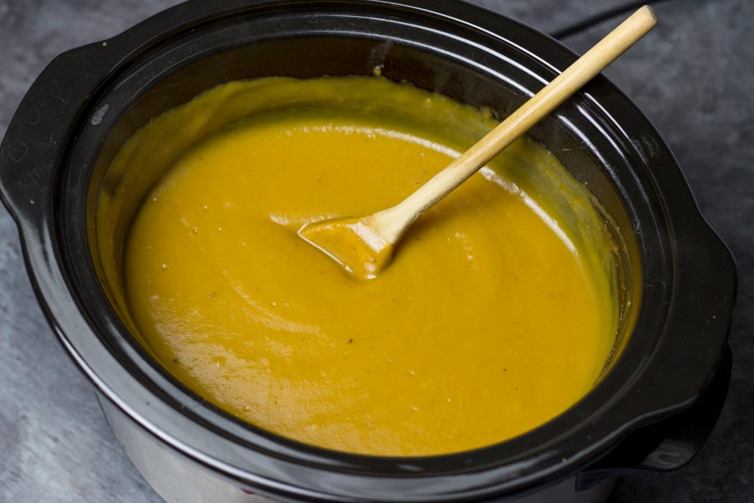 slow cooker pumpkin soup blended in a slow cooker