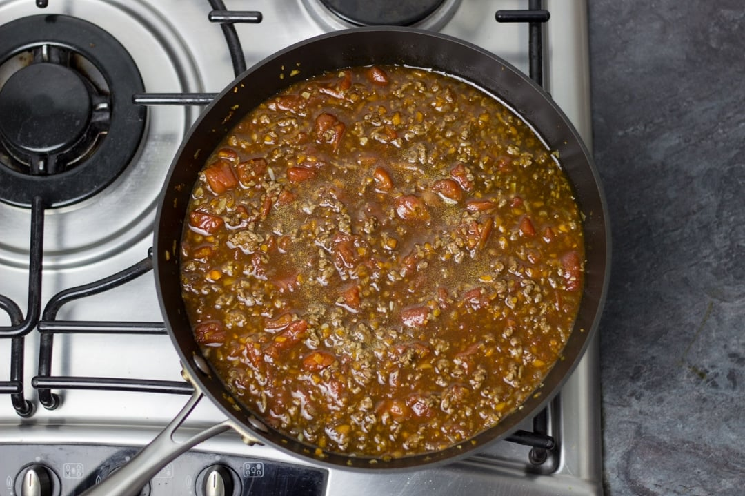 Easy spaghetti bolognese mince cooking in a large saucepan