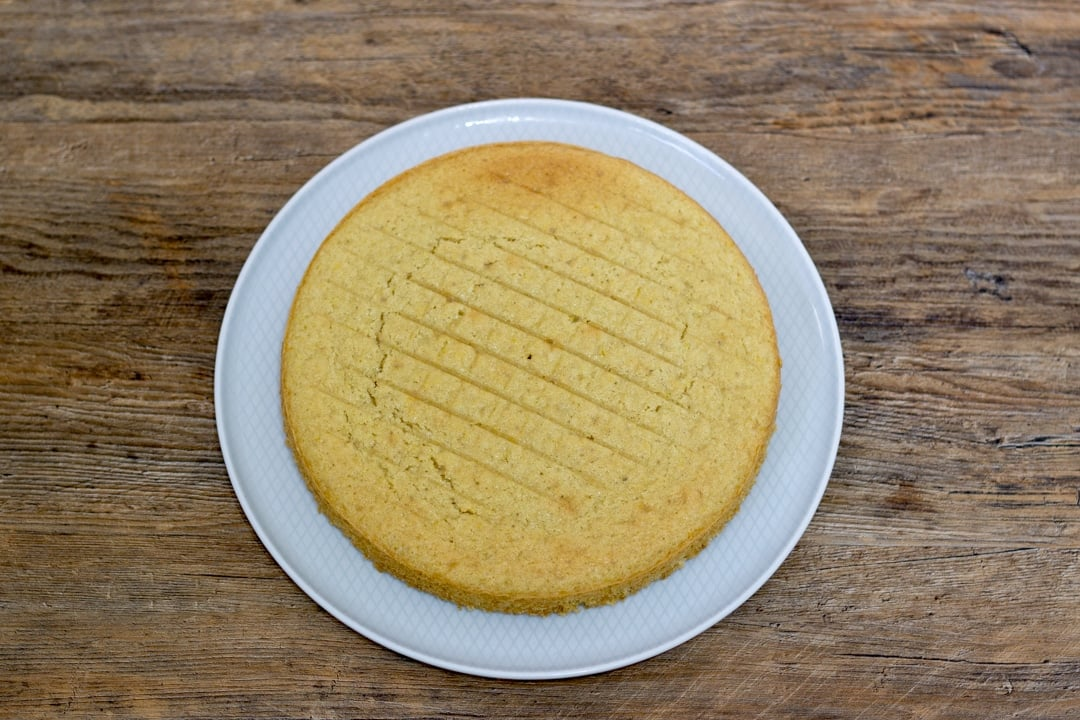 dairy free / vegan lemon bottom cake layer on a plate