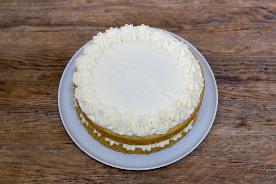 dairy free / vegan lemon cake decorated with frosting