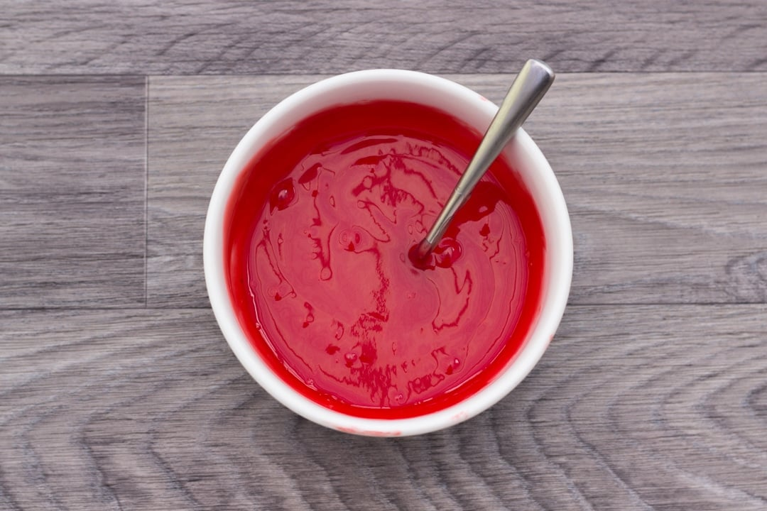lemon curd coloured red in a bowl