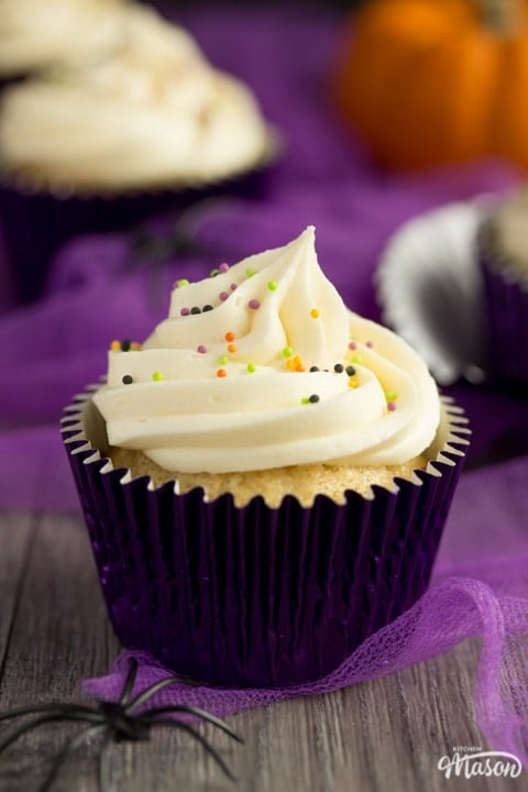 halloween cupcakes with a fake spider and purple tuille