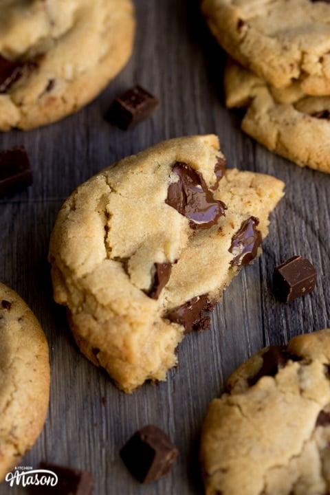 vegan chocolate chip cookies broken in half with melting chocolate chips