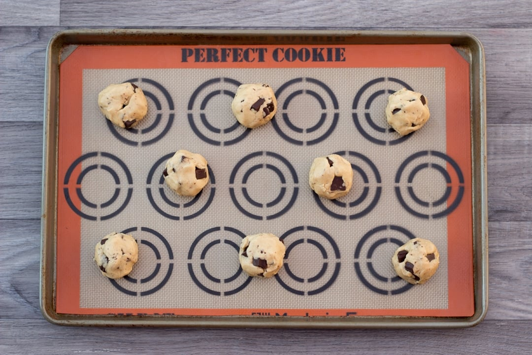 vegan chocolate chip cookie dough balls on a baking tray