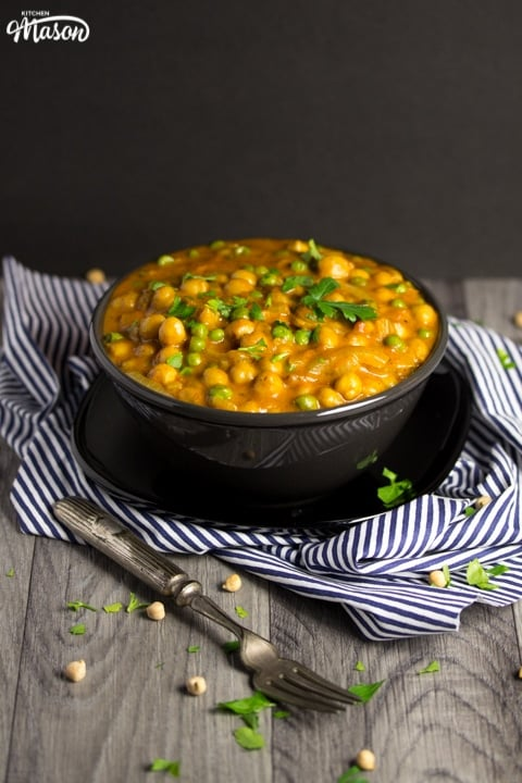 coconut chickpea curry in a bowl with parsley scattered on top